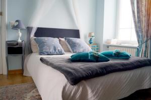 Un ou plusieurs lits dans un hébergement de l'établissement Maison d'hôtes du Carrec