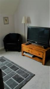 A television and/or entertainment center at Trough Ivy House B&B