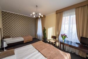 Łóżko lub łóżka w pokoju w obiekcie Hotel Restauracja Tęczowa