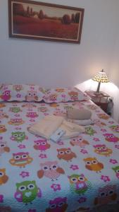 A bed or beds in a room at Solar Beija Flor Residence