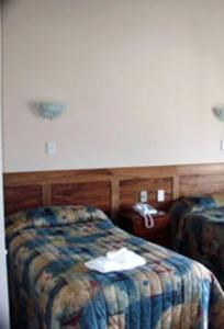 A bed or beds in a room at South Sea Hotel - Stewart Island