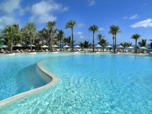 The swimming pool at or near LUX* Belle Mare Resort & Villas