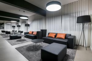 Coin salon dans l'établissement Apartamentos Turisticos Paraiso