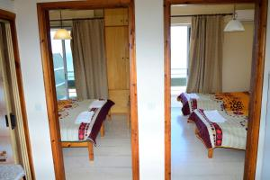 A bed or beds in a room at Pantelis