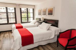 A bed or beds in a room at Hotel Bogota Virrey