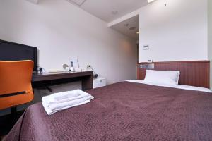 A bed or beds in a room at Hotel Select Inn Saitama Moroyama