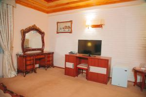 A television and/or entertainment center at Arba Hotel