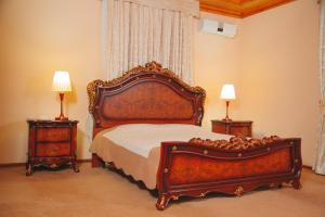 A bed or beds in a room at Arba Hotel
