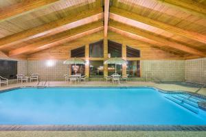 The swimming pool at or near Days Inn & Suites by Wyndham Baxter Brainerd Area