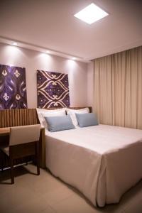 A bed or beds in a room at Ebenezer Village Pousada Centro