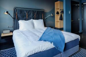A bed or beds in a room at The Duke Boutique Hotel