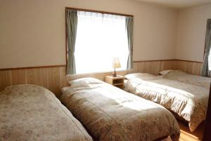 A bed or beds in a room at Pension Avenue