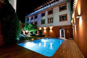 The swimming pool at or near Hotel Infanta Leonor