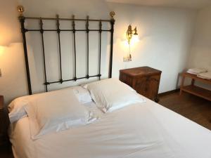 Cama o camas de una habitación en La Casa Del Reloj