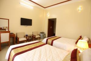 Giường trong phòng chung tại Royal Hotel Ha Giang