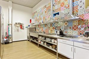 A kitchen or kitchenette at Hostelle - female only hostel