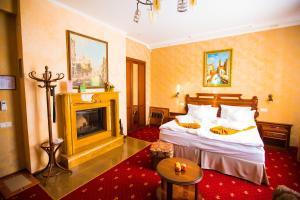 Кровать или кровати в номере Бутик - Отель 13 Стульев