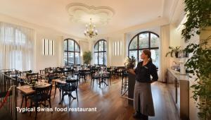 Ein Restaurant oder anderes Speiselokal in der Unterkunft Hotel National Bern