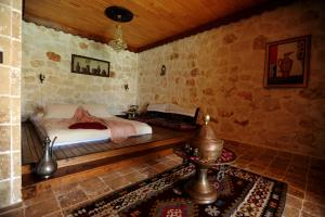 A bed or beds in a room at Likya Yolu Palas Hotel