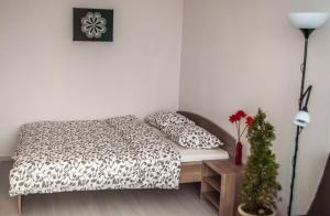 A bed or beds in a room at Vnukovo Airport Apartments