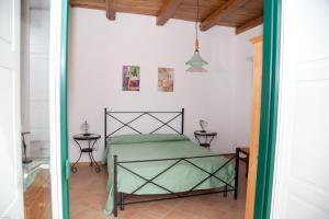 Letto o letti in una camera di Palazzo Della Cortiglia
