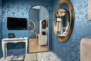 A television and/or entertainment center at GKK Exclusive Private suite Venezia