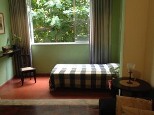 Cama ou camas em um quarto em Copacabana apartment with 3 rooms and seasight
