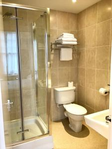 A bathroom at Churchills Hotel