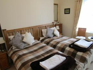 A bed or beds in a room at Harringtons at 14