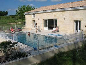The swimming pool at or near Gite Le Chardon Fleuri