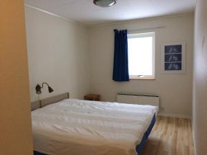 Säng eller sängar i ett rum på Siljan Utsikt Semesterhus