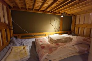 A bed or beds in a room at ML International Hostel