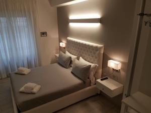 Letto o letti in una camera di Notte a San Pietro