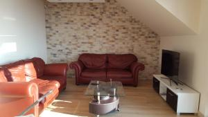 A seating area at Fantastic View Apartments Beskid Mountains