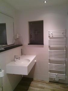 Ein Badezimmer in der Unterkunft Hotel-Restaurant Heiligenstadter Hof