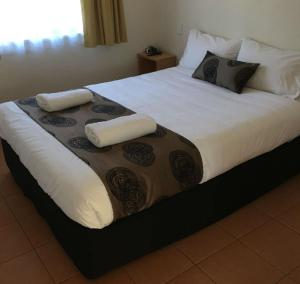 A bed or beds in a room at NRMA Bowen Beachfront Holiday Park