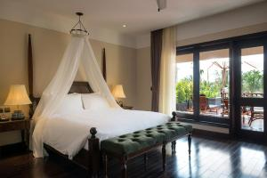 A bed or beds in a room at La Siesta Hoi An Resort & Spa