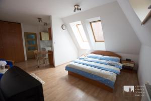 A bed or beds in a room at Kulturne Centrum Bardejov