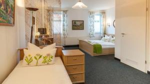 Ein Bett oder Betten in einem Zimmer der Unterkunft Hotel Torgauer Brauhof