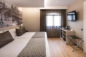 Cama o camas de una habitación en Catalonia Born