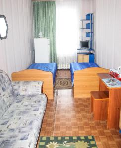 Кровать или кровати в номере Hostel Prometey
