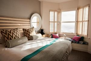 A bed or beds in a room at Brighton Harbour Hotel & Spa