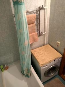 Ванна кімната в Apartment on Malinovskoho street 25