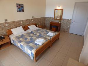 Ένα ή περισσότερα κρεβάτια σε δωμάτιο στο Paradiso Aparthotel