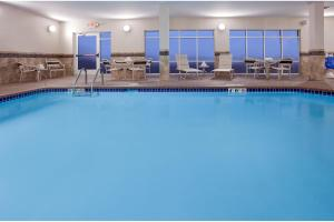 The swimming pool at or near AmericInn by Wyndham Sibley