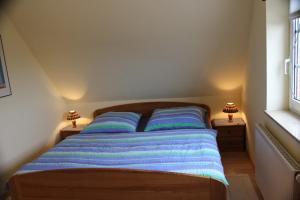 Ein Bett oder Betten in einem Zimmer der Unterkunft Ferienhaus Christa