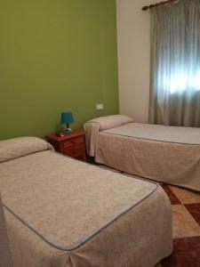 A bed or beds in a room at Pension Pinzapa