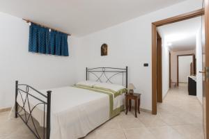 Letto o letti in una camera di Villetta Oltremare