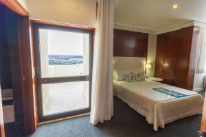 Кровать или кровати в номере Eurosol Leiria & Eurosol Jardim