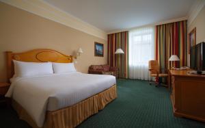 Кровать или кровати в номере Отель Марриотт Москва Гранд